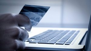 hand_card_money_online_purchase_laptop